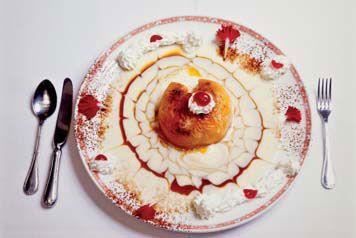 Melocotones asados rellenos de helado (Restaurante asador la encina)